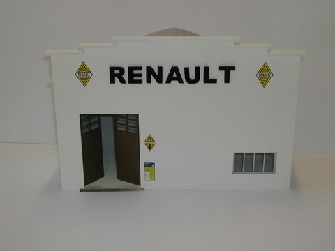 Fa ade garage avec portes battantes renault for Renault service garage